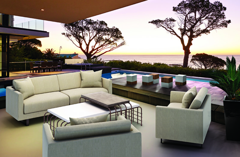 Modern luxury home showcase patio and swimming pool overlooking ocean view at sunset