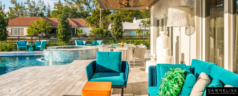 Beautiful indoor outdoor living area designed by Dawn Elise Interiors in Ft. Lauderdale, Florida, using Seasonal Living Trading Company furniture and accessories